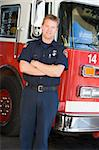 Portrait of a firefighter by a fire engine Stock Photo - Royalty-Free, Artist: MonkeyBusinessImages, Code: 400-04036423