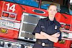 Portrait of a firefighter by a fire engine Stock Photo - Royalty-Free, Artist: MonkeyBusinessImages, Code: 400-04036424