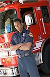 Portrait of a firefighter by a fire engine Stock Photo - Royalty-Free, Artist: MonkeyBusinessImages, Code: 400-04036425