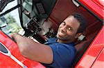 A firefighter sitting in the cab of a fire engine Stock Photo - Royalty-Free, Artist: MonkeyBusinessImages, Code: 400-04036434