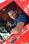 A firefighter sitting in the cab of a fire engine Stock Photo - Royalty-Free, Artist: MonkeyBusinessImages, Code: 400-04036435