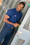 Portrait of a firefighter in the fire station locker room Stock Photo - Royalty-Free, Artist: MonkeyBusinessImages, Code: 400-04036441