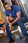 Portrait of a firefighter in the fire station locker room Stock Photo - Royalty-Free, Artist: MonkeyBusinessImages, Code: 400-04036446