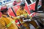 Firefighters cutting open a car to help an injured person Stock Photo - Royalty-Free, Artist: MonkeyBusinessImages, Code: 400-04036456
