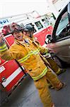 Firefighters cutting open a car to help an injured person Stock Photo - Royalty-Free, Artist: MonkeyBusinessImages, Code: 400-04036457