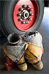 Empty firefighter's boots and uniform next to fire engine Stock Photo - Royalty-Free, Artist: MonkeyBusinessImages, Code: 400-04036468