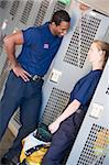 Firefighters in the fire station locker room Stock Photo - Royalty-Free, Artist: MonkeyBusinessImages, Code: 400-04036470