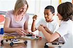 Schoolchildren and their teacher in a science class Stock Photo - Royalty-Free, Artist: MonkeyBusinessImages, Code: 400-04036546