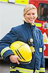 Portrait of a firefighter standing in front of a fire engine Stock Photo - Royalty-Free, Artist: MonkeyBusinessImages, Code: 400-04036596