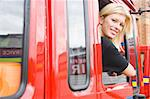 Female firefighter sitting in the cab of a fire engine Stock Photo - Royalty-Free, Artist: MonkeyBusinessImages, Code: 400-04036607