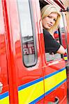 Female firefighter sitting in the cab of a fire engine Stock Photo - Royalty-Free, Artist: MonkeyBusinessImages, Code: 400-04036608