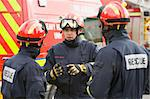 A firefighter giving instructions to his team Stock Photo - Royalty-Free, Artist: MonkeyBusinessImages, Code: 400-04036616