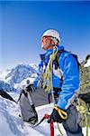 Young man mountain climbing on snowy peak Stock Photo - Royalty-Free, Artist: MonkeyBusinessImages, Code: 400-04037280