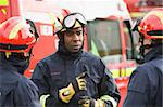 A firefighter giving instructions to his team Stock Photo - Royalty-Free, Artist: MonkeyBusinessImages, Code: 400-04037762