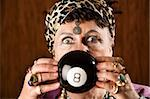 Gypsy looking at an eight ball to predict the future Stock Photo - Royalty-Free, Artist: creatista, Code: 400-04038955