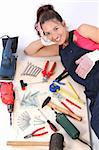 woman carpenter with work tools on wooden plank Stock Photo - Royalty-Free, Artist: vladacanon, Code: 400-04039016