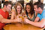 Group of young friends toasting in a bar Stock Photo - Royalty-Free, Artist: MonkeyBusinessImages, Code: 400-04040282