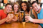 Group of young friends in bar toasting the camera Stock Photo - Royalty-Free, Artist: MonkeyBusinessImages, Code: 400-04040284