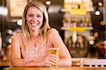 Young woman enjoying a beer at a bar Stock Photo - Royalty-Free, Artist: MonkeyBusinessImages, Code: 400-04040286