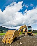 Earthmover parked in rural surroundings with nice cloudy sky! Stock Photo - Royalty-Free, Artist: thomland, Code: 400-04041410