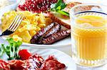plate of wholesome breakfast with scrambled eggs, bacon, orange juice, and toast with jam. Stock Photo - Royalty-Free, Artist: hojo, Code: 400-04042463