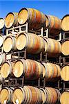 Wine barrels stacked high against a clear blue sky Stock Photo - Royalty-Free, Artist: karimala, Code: 400-04042595