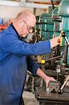 Machinist working on machine Stock Photo - Royalty-Free, Artist: MonkeyBusinessImages, Code: 400-04045051