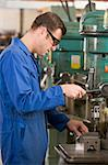Machinist working on machine Stock Photo - Royalty-Free, Artist: MonkeyBusinessImages, Code: 400-04045064