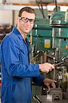 Machinist working on machine Stock Photo - Royalty-Free, Artist: MonkeyBusinessImages, Code: 400-04045065