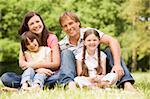 Family outdoors smiling Stock Photo - Royalty-Free, Artist: MonkeyBusinessImages, Code: 400-04045428