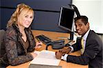 Indian Business Man and Caucasian Woman Signing a Contract Stock Photo - Royalty-Free, Artist: surpasspro, Code: 400-04051563