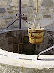 A water well with an old bucket in Fort Louisburg, Nova Scotia. Stock Photo - Royalty-Free, Artist: sumners, Code: 400-04051642