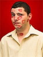 man portrait with many kisses on his face Stock Photo - Royalty-Freenull, Code: 400-04058787