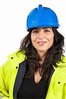 Female construction worker portrait, over a white background Stock Photo - Royalty-Free, Artist: broker, Code: 400-04059251