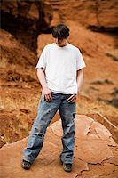 Teen in nature, in wilderness area standing on large flat rock Stock Photo - Royalty-Freenull, Code: 400-04059433