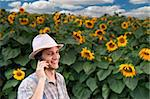 farmer standing in front of a sunflower field talking on the phone Stock Photo - Royalty-Free, Artist: Noam, Code: 400-04064851