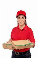 fat italian woman - A pizza delivery woman holding three boxes. Isolated on white Stock Photo - Royalty-Freenull, Code: 400-04065070