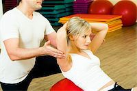 skinny man muscle pose - Photo of woman doing physical exercise with man near by Stock Photo - Royalty-Freenull, Code: 400-04065634