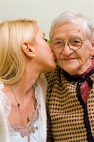 A young woman kissing an older one  (focus on the elderly) - part of a series. Stock Photo - Royalty-Freenull, Code: 400-04081831