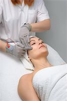 woman getting special electric facial massage in the beauty salon Stock Photo - Royalty-Freenull, Code: 400-04082511