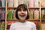 young girl smiling in awe at rows of sweets Stock Photo - Royalty-Free, Artist: gemphotography, Code: 400-04097623