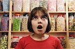 young girl looking in awe at rows of sweets Stock Photo - Royalty-Free, Artist: gemphotography, Code: 400-04097624