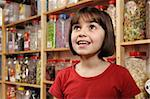 young girl smiling in awe at rows of sweets Stock Photo - Royalty-Free, Artist: gemphotography, Code: 400-04097625