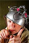 Crazy woman wearing a metal colander for a helmet Stock Photo - Royalty-Free, Artist: creatista, Code: 400-04102938