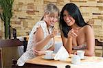 two friends having a good time in a cafe smiling and chatting Stock Photo - Royalty-Free, Artist: carlodapino, Code: 400-04103835