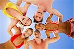 Group of five young people in circle looking at camera with blue sky above Stock Photo - Royalty-Free, Artist: pressmaster, Code: 400-04106598