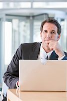 Senior business man working on laptop Stock Photo - Royalty-Freenull, Code: 400-04111365