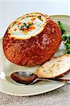 Lunch of soup served in baked round bread bowl Stock Photo - Royalty-Free, Artist: Elenathewise, Code: 400-04112155