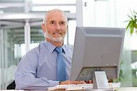 Business man working on laptop Stock Photo - Royalty-Freenull, Code: 400-04113367