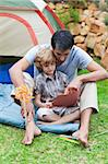 Attractive father and son playing in a tent Stock Photo - Royalty-Free, Artist: 4774344sean, Code: 400-04114606